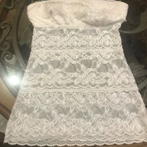 Bebe lace white smocked back lace tube top.